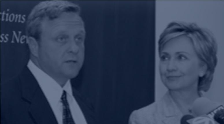 Thomas Blaszczykiewicz standing with Hillary Clinton.
